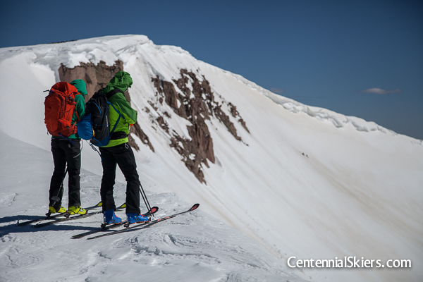Christy and Chris assess the ski options. We ascended a rather tame and uninteresting route, so the option of skiing the big east facing bowl pictured here was appealing.