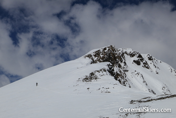It's a well defined mountain with a rather small summit and multiple ski options-- it should have a proper name.