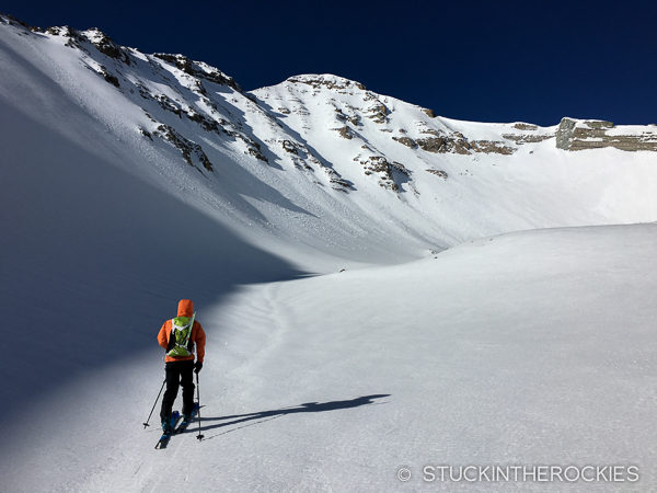 Max Taam skins up towards the North Couloir on Castle Peak.