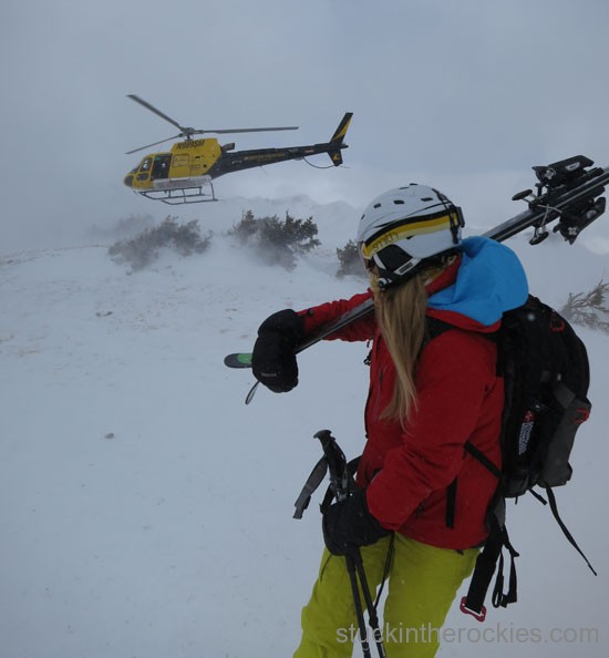 Christy waits while the heli loads up to do some avy control work.