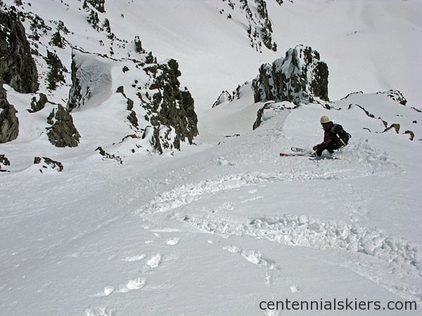 After heading skier's right from the summit, some couloirs show the way down.