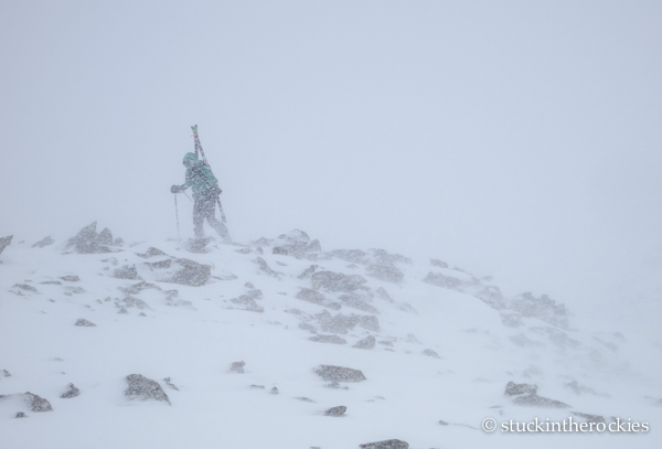 Climbing back up to the cairn, in the driving storm.