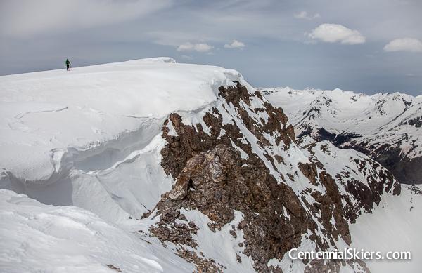 Dav makes his way to the exact summit.