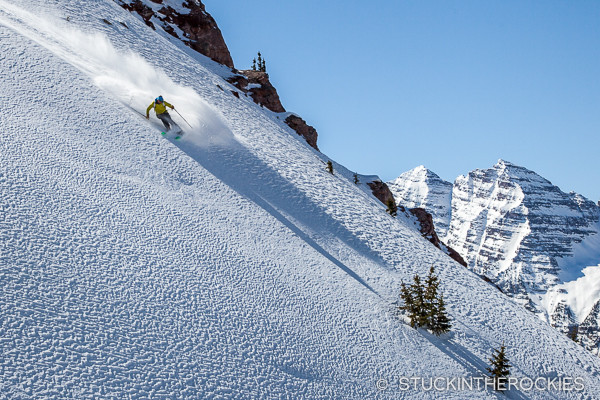 Chris Davenport backcountry skiing with the Maroon Bells