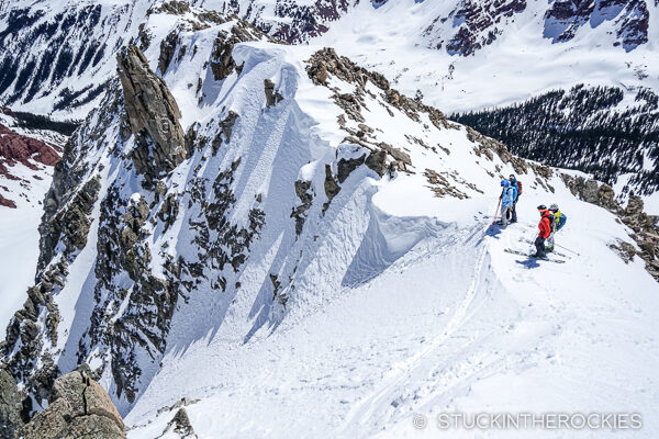 The ski group scouting the couloir on Willow Peak