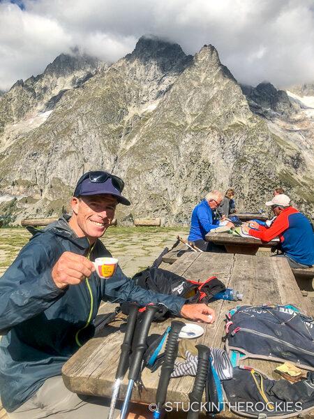 Ted Mahon having an espresso at the Bonatti Hut on the Tour du Mont Blanc