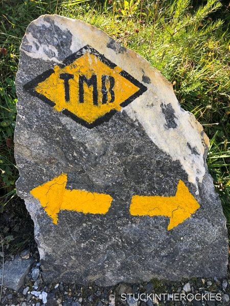 A trail sign marking the Tour du Mont Blanc route