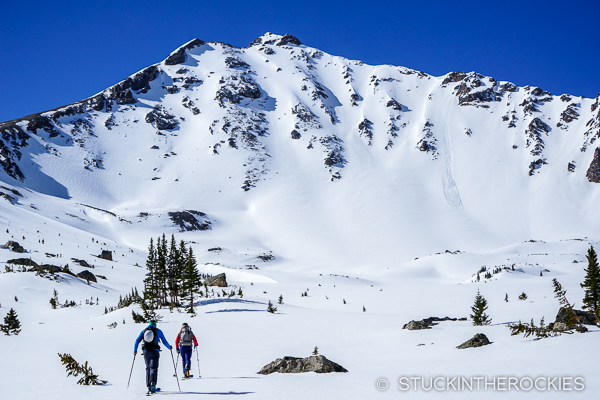 Christy Mahon and Chris Davenport approach the North Face of Deer Mountain